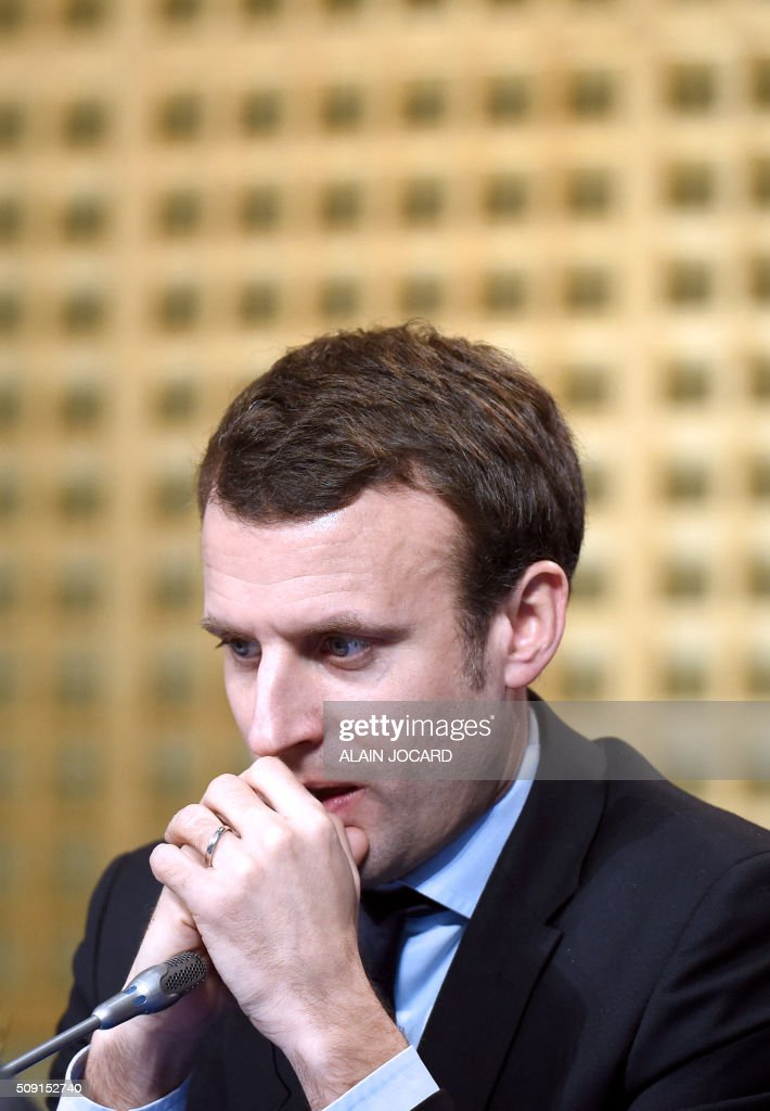 French Economy and Industry minister Emmanuel Macron takes part in a press conference during the Franco-German Economic Council, on February 9, 2016, in Paris. / AFP / ALAIN JOCARD