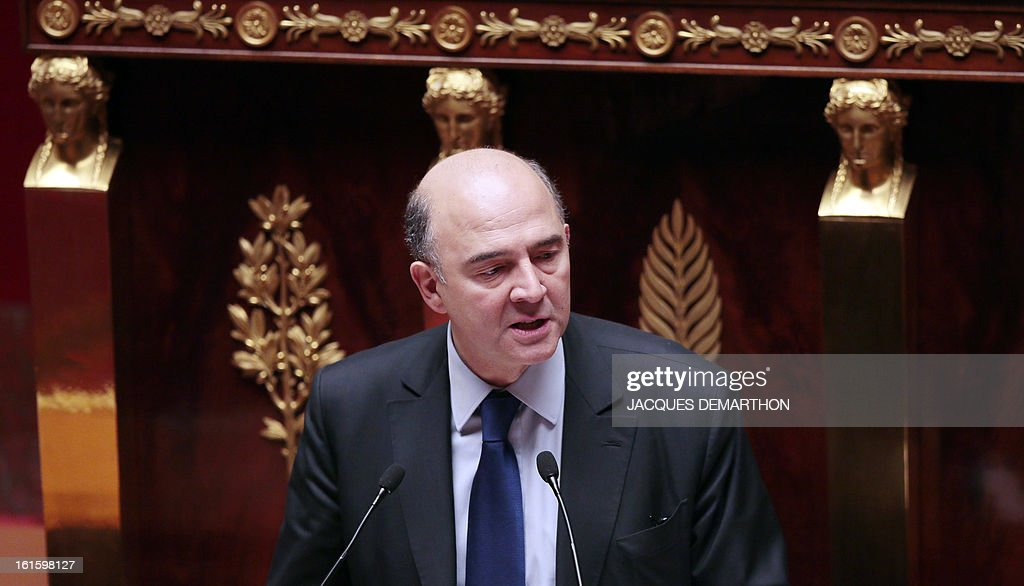 French Economy, Finance and Foreign Trade Minister, Pierre Moscovici presents a bill on separation and regulation of banking activities on February 12, 2013 at the French National Assembly in Paris.