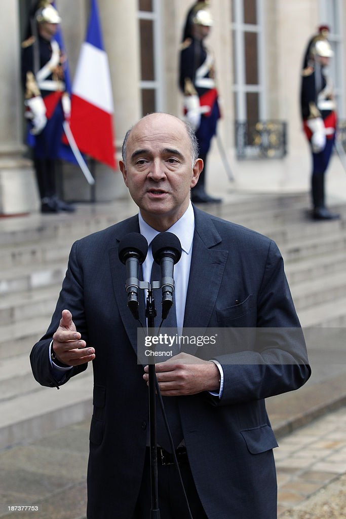 French Economy, Finance and Foreign Trade Minister, Pierre Moscovici makes a statement after a meeting with French President Francois Hollande and leaders of the world organizations linked to G20 at the Elysee presidential Palace on November 8, 2013 in Paris.The rating of France's sovereign debt has been downgraded for the second time in two years, as ratings agency Standard and Poor's cut the nation's credit rating from AA+ to AA.