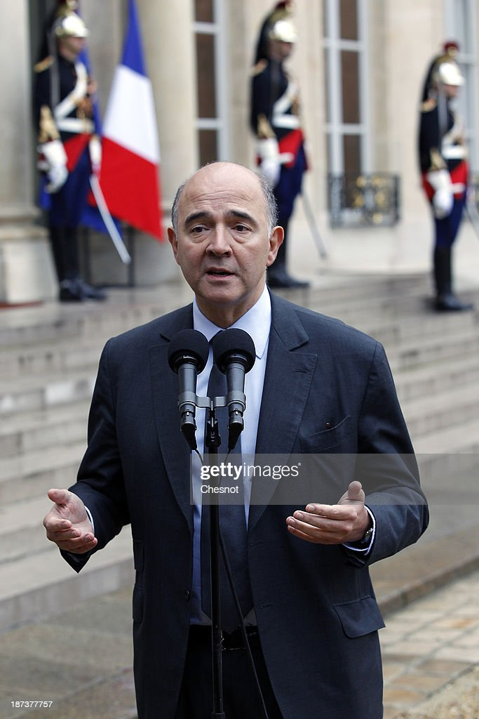 French Economy, Finance and Foreign Trade Minister, <a gi-track='captionPersonalityLinkClicked' href=/galleries/search?phrase=Pierre+Moscovici&family=editorial&specificpeople=667029 ng-click='$event.stopPropagation()'>Pierre Moscovici</a> makes a statement after a meeting with French President Francois Hollande and leaders of the world organizations linked to G20 at the Elysee presidential Palace on November 8, 2013 in Paris.The rating of France's sovereign debt has been downgraded for the second time in two years, as ratings agency Standard and Poor's cut the nation's credit rating from AA+ to AA.