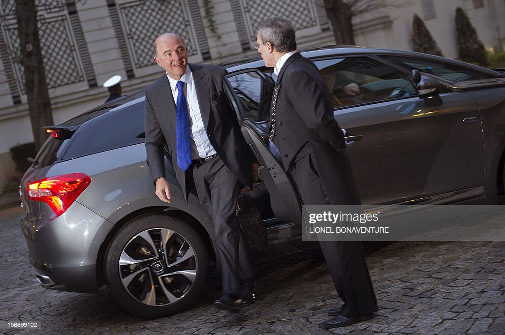 French Economy, Finance and Foreign Trade Minister, Pierre Moscovici arrives at the Ministry of Interior to attend a breakfast with ministers on January 3, 2013 in Paris. AFP PHOTO LIONEL BONAVENTURE
