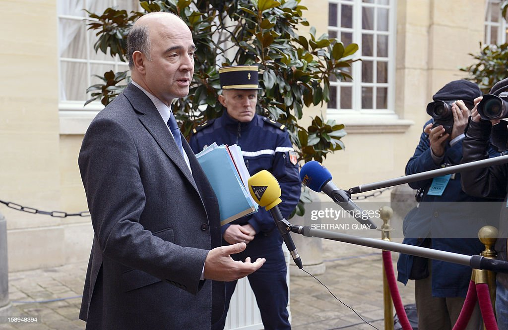 French Economy, Finance and Foreign Trade Minister, Pierre Moscovici (L) answers the media on January 4, 2013 at the Hotel Matignon in Paris, after a seminar with French ministers, focused on French government's agenda for the coming year. AFP PHOTO BERTRAND GUAY