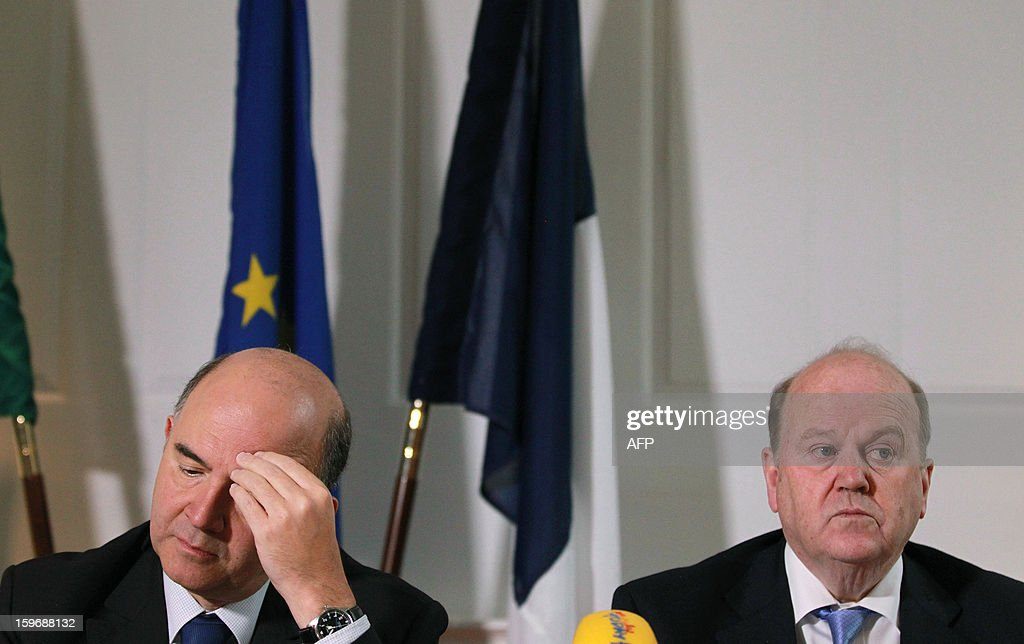 French Economy, Finance and Foreign Trade Minister Pierre Moscovici (L) gestures during a joint press conference with his Irish counterpart Michael Noonan (R) at the Finance Office in Dublin, Ireland on January 18, 2013.