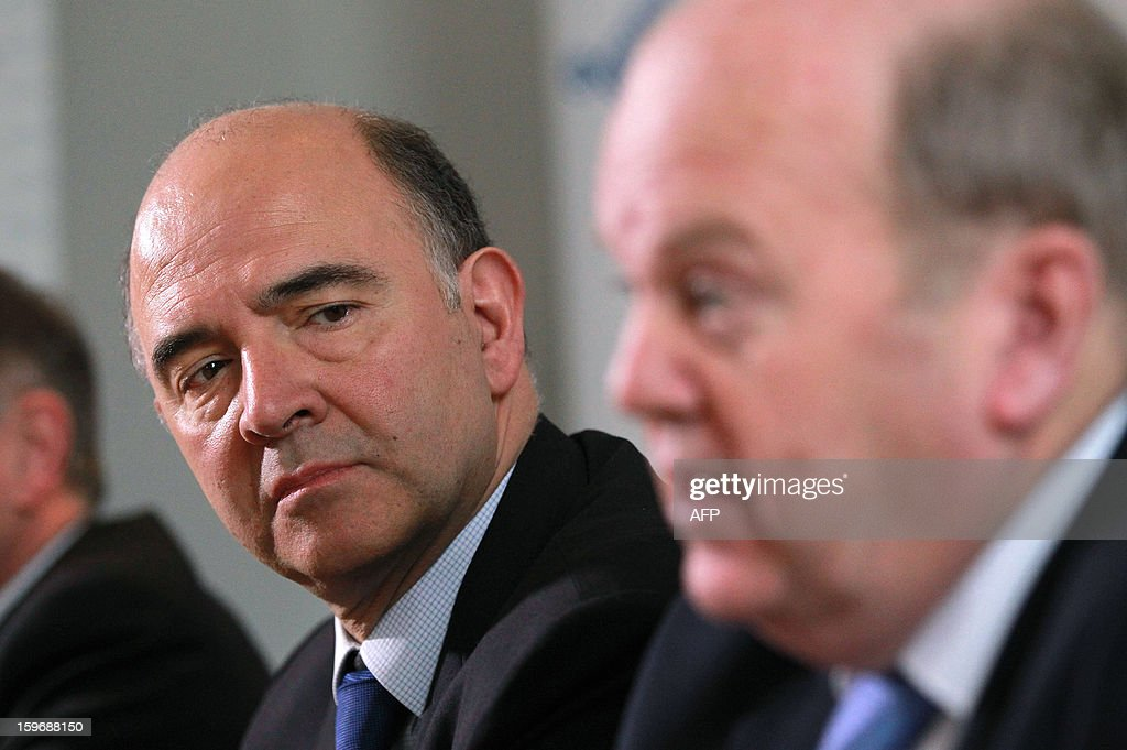 French Economy, Finance and Foreign Trade Minister Pierre Moscovici (L) listens to his Irish counterpart Michael Noonan during a joint press conference at the Finance Office in Dublin, Ireland on January 18, 2013.