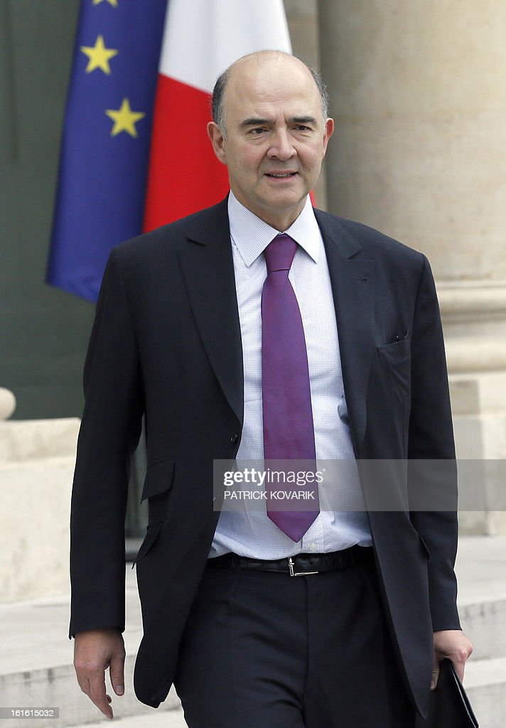 French Economy, Finance and Foreign Trade Minister, Pierre Moscovici leaves the Elysee Presidential Palace after the weekly cabinet meeting, on February 13, 2013, in Paris. AFP PHOTO PATRICK KOVARIK