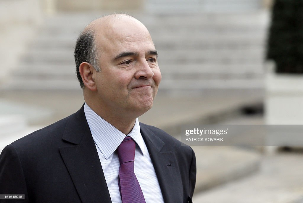 French Economy, Finance and Foreign Trade Minister, Pierre Moscovici leaves the Elysee Presidential Palace after the weekly cabinet meeting, on February 13, 2013, in Paris.