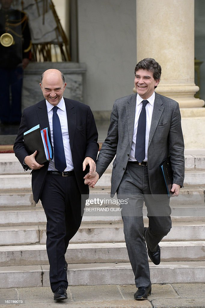 French Economy, Finance and Foreign Trade Minister, Pierre Moscovici (L) and French minister for Industrial Renewal, Arnaud Montebourg leave the Elysee Presidential Palace in Paris on February 27, 2013, at the end of the weekly cabinet meeting.