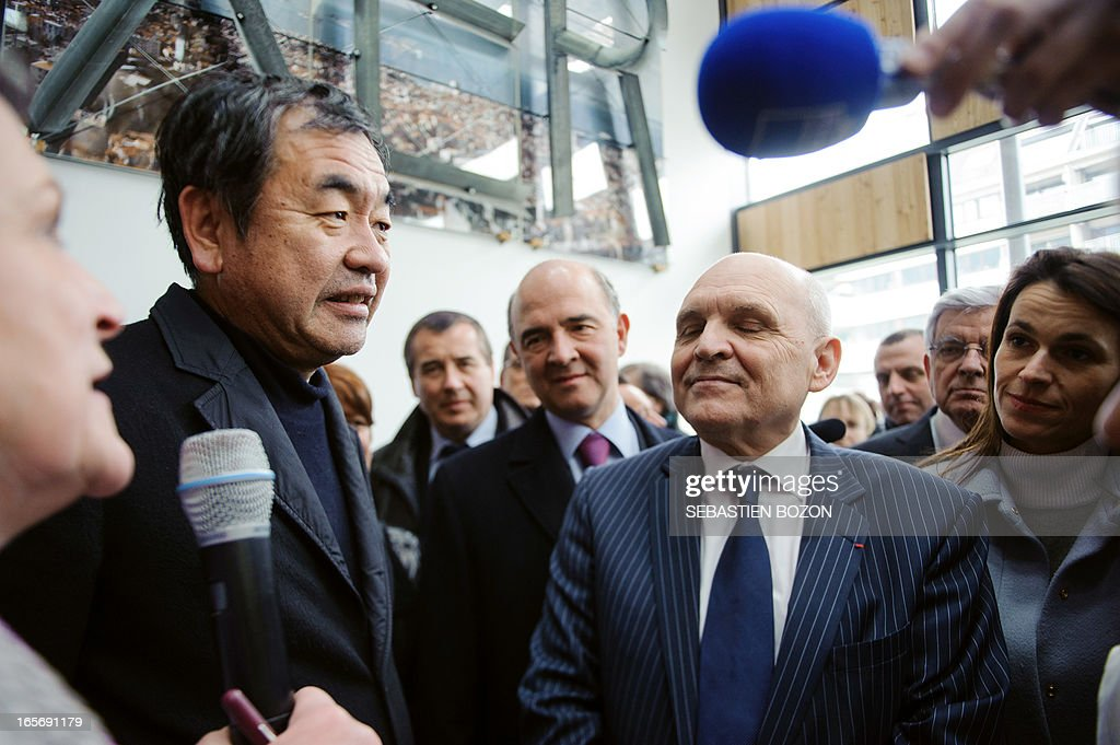 French Economy, Finance and Foreign Trade Minister Pierre Moscovici (back C) and French Minister for Culture and Communication Aurelie Filippetti (L)attend the inauguration of Japanese architect Kengo Kuma's (2L) new building 'La Cité des Arts' in Besancon on April 5, 2013.