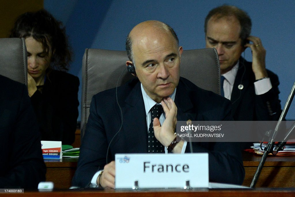 French Economy, Finance and Foreign Trade Minister Pierre Moscovici (C) attends the plenary session during the G20 Finance Ministers and Central Bank Governors' meeting in Moscow on July 19, 2013. Finance ministers and central bankers from G20 countries meet for a two-day meeting on Friday seeking to intensify the battle against tax evasion and prevent a new global slowdown.