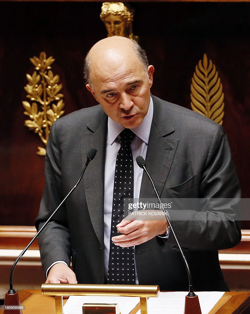 French Economy, Finance and Foreign Trade minister Pierre Moscovici speaks during a debate at the National Assembly in Paris on a law aimed at putting pressure on companies leaving an industrial site unused to transfer the property and site to another company or the state, on September 18, 2013.
