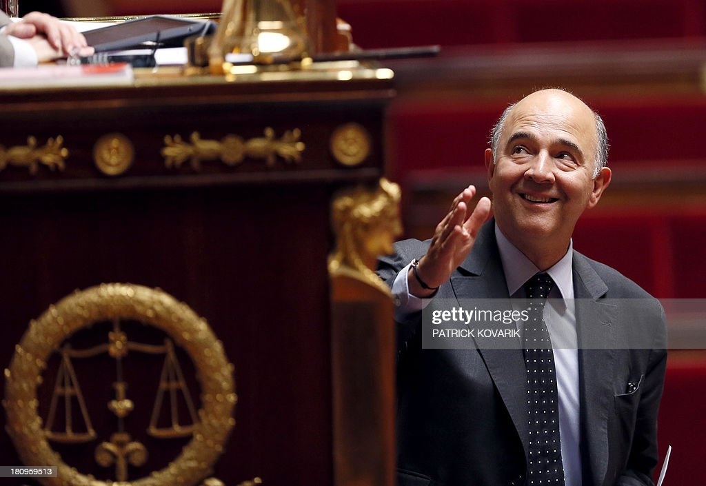 French Economy, Finance and Foreign Trade minister Pierre Moscovici gestures before speaking during a debate at the National Assembly in Paris on a law aimed at putting pressure on companies leaving an industrial site unused to transfer the property and site to another company or the state, on September 18, 2013.