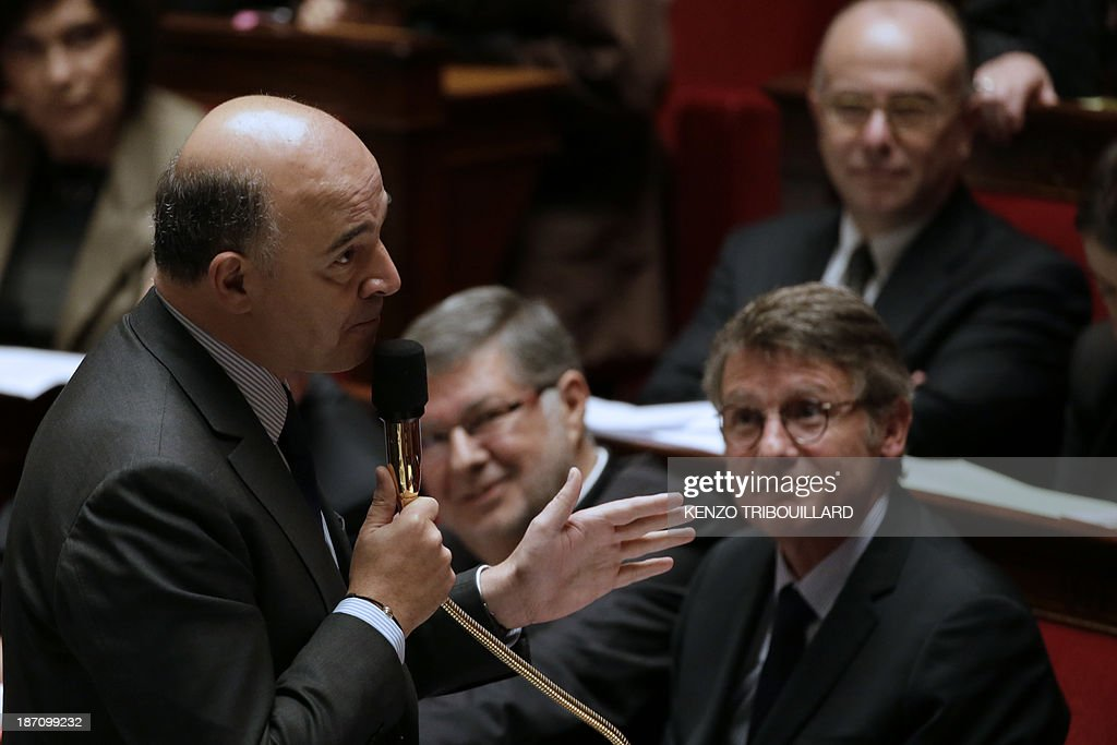 French Economy, Finance and Foreign Trade Minister, Pierre Moscovici speaks during a weekly session of questions to the government on November 06, 2013 at the National Assembly in Paris. AFP PHOTO / KENZO TRIBOUILLARD