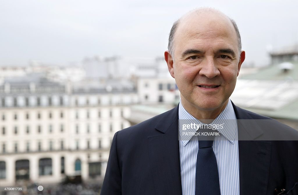 French Economy, Finance and Foreign Trade Minister <a gi-track='captionPersonalityLinkClicked' href=/galleries/search?phrase=Pierre+Moscovici&family=editorial&specificpeople=667029 ng-click='$event.stopPropagation()'>Pierre Moscovici</a> poses for a photograph in Paris, on February 18, 2014. AFP PHOTO / PATRICK KOVARIK