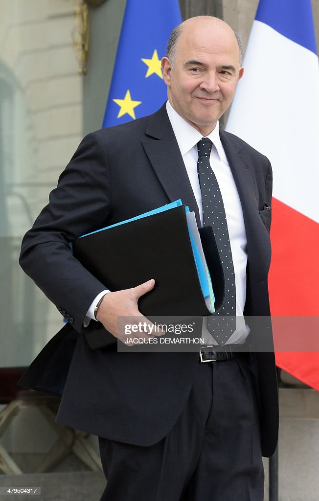 French Economy, Finance and Foreign Trade Minister <a gi-track='captionPersonalityLinkClicked' href=/galleries/search?phrase=Pierre+Moscovici&family=editorial&specificpeople=667029 ng-click='$event.stopPropagation()'>Pierre Moscovici</a> leaves the Elysee Palace in Paris after the weekly cabinet meeting, on March 19, 2014. AFP PHOTO/JACQUES DEMARTHON