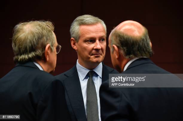 French Economy Finance Trade Minister Bruno Le Maire reacts while speaking with Italian Minister of Economy and Finance Pier Carlo Padoan and Spain's...