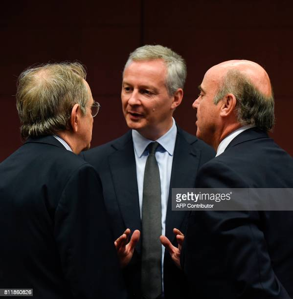 French Economy Finance Trade Minister Bruno Le Maire speaks with Italian Minister of Economy and Finance Pier Carlo Padoan and Spain's Economy...