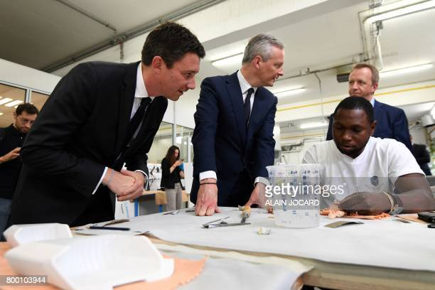 French Economy Minister Bruno Le Maire and French Junior Economy Minister Benjamin Griveaux speak with an employee as they visit the ERPO SPRINT...