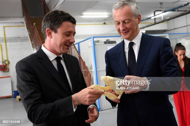 French Economy Minister Bruno Le Maire and French Junior Economy Minister Benjamin Griveaux look at a 3D printed skull as they visit the ERPO SPRINT...