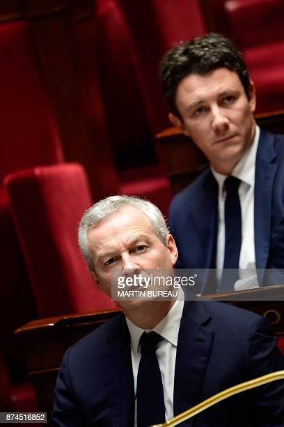 French Economy Minister Bruno Le Maire and French Junior Economy Minister Benjamin Griveaux attend a session of questions to the government at the...