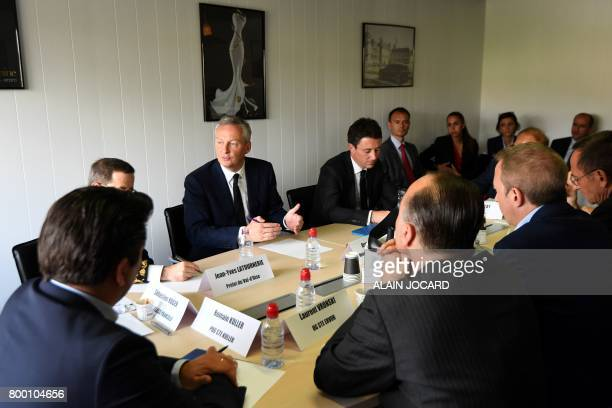 French Economy Minister Bruno Le Maire flanked by French Junior Economy Minister Benjamin Griveaux gestures as he speaks during a meeting at the ERPO...