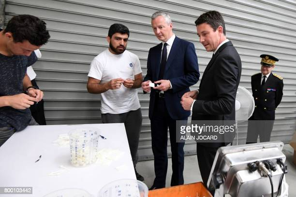 French Economy Minister Bruno Le Maire French Junior Economy Minister Benjamin Griveaux and prefect of the ValdOise department JeanYves Latournerie...