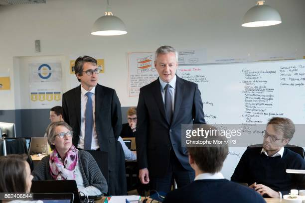 French Economy Minister Bruno Le Maire inaugurates the Digital Factory by Thales with Thales CEO Patrice Caine on October 17 2017 in Paris France The...