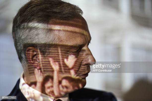 French Economy Minister Bruno Le Maire looks on during a visit to the headquarters of Somfy in Cluses eastern France on August 25 as images are...