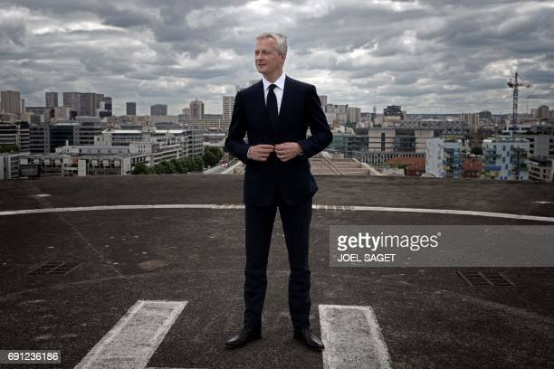 French Economy Minister Bruno Le Maire poses during a photo session on the helipad on the roof of his ministry on May 30 2017 in Paris / AFP PHOTO /...