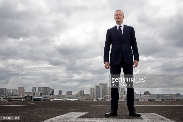 TOPSHOT French Economy Minister Bruno Le Maire poses on the heliport of his ministry on May 30 2017 in Paris / AFP PHOTO / JOEL SAGET