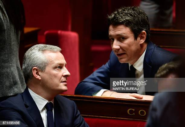 French Economy Minister Bruno Le Maire speaks to French Junior Economy Minister Benjamin Griveaux during a session of questions to the government at...
