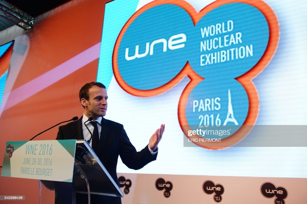 French Economy Minister Emmanuel Macron addresses the opening session of the World Nuclear Exhibition in Le Bourget, near Paris, on June 28, 2016. / AFP / ERIC