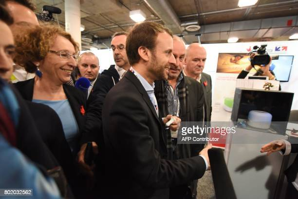 French Economy Minister Emmanuel Macron and CEO of Business France a national agency promoting foreign investment in France Muriel Penicaud visit...