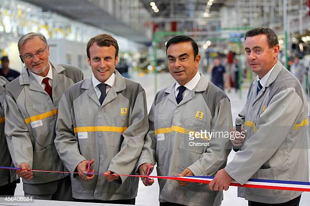 French Economy Minister Emmanuel Macron and French Renault car maker CEO Carlos Ghosn take part in the inauguration of a new production plant of the...