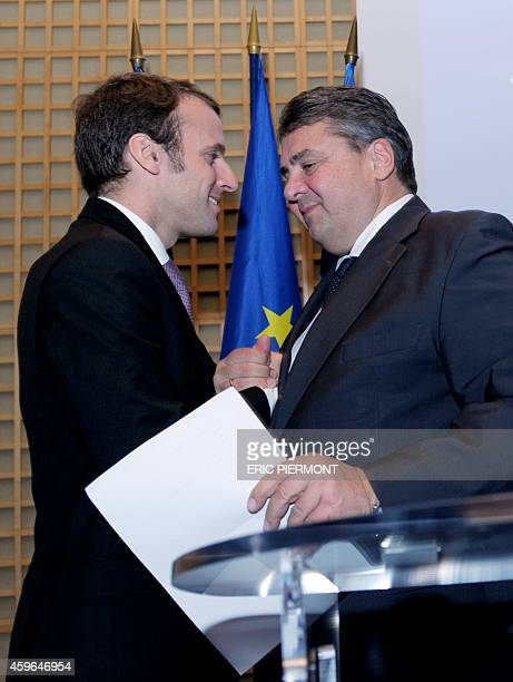 French Economy Minister Emmanuel Macron and German ViceChancellor and Economy and Energy Minister Sigmar Gabriel shake hands at the end of a press...