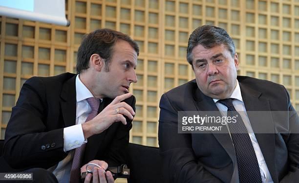 French Economy Minister Emmanuel Macron and German ViceChancellor and Economy and Energy Minister Sigmar Gabriel talk together during a press...