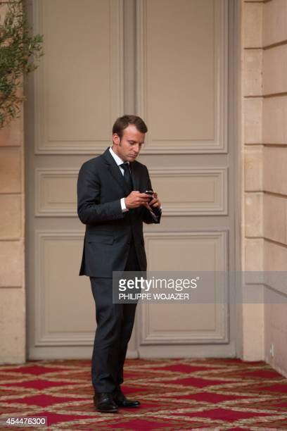 French Economy minister Emmanuel Macron arrives at a dinner attended by French President Francois Hollande and Saudi Crown Prince Salman bin Abdul...