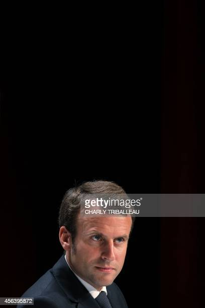 French Economy Minister Emmanuel Macron attends a press conference after the inauguration of a new production plant of French Renault car maker on...