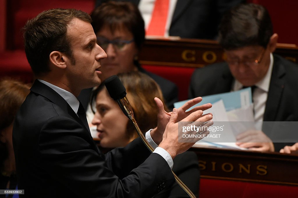 French Economy minister Emmanuel Macron delivers a speech during a session of Questions to the Government, on May 24, 2016 at the National Assembly in Paris.