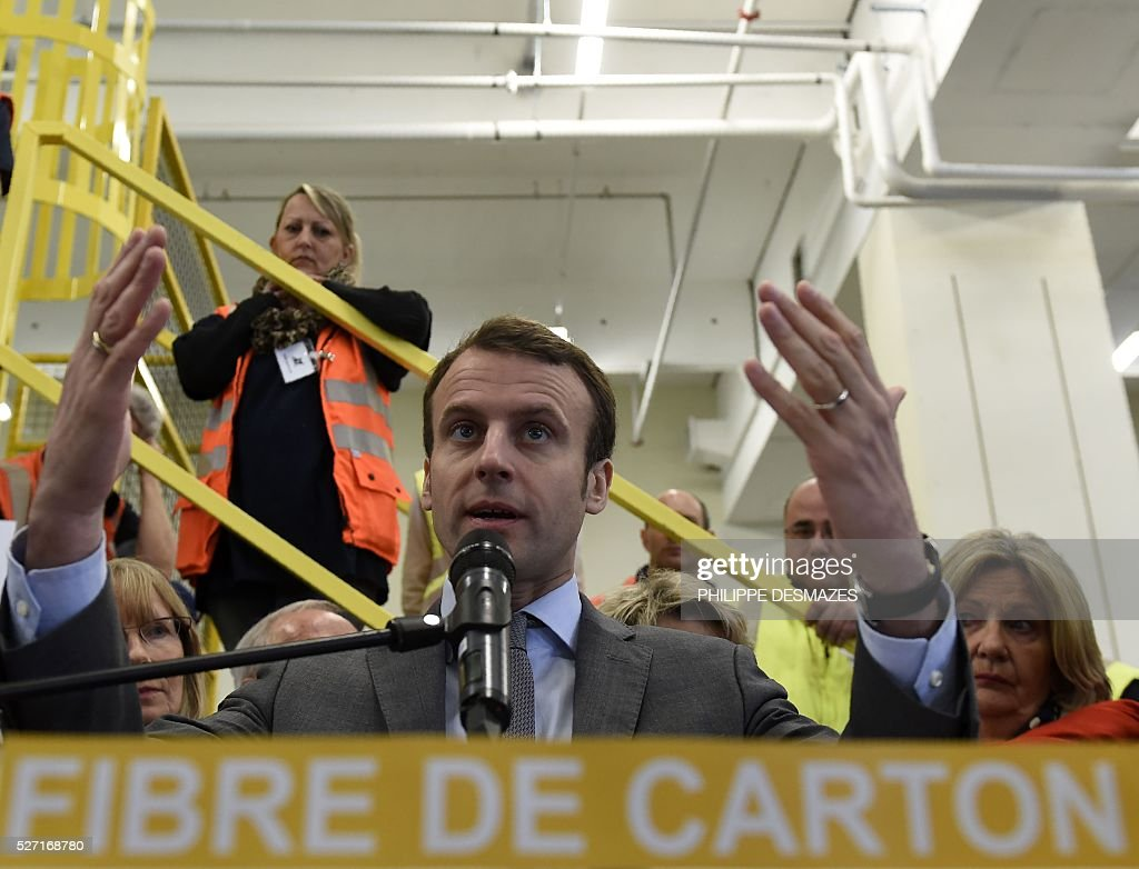 French Economy minister Emmanuel Macron delivers a speech during the inauguration of ID'EES group's new factory IDEM, that produces cellulose wadding from cardboard, on May 2, 2016, in Fragnes central-eastern France. ID'EES group is one of the French leaders of people's integration through the economic sector. / AFP / PHILIPPE