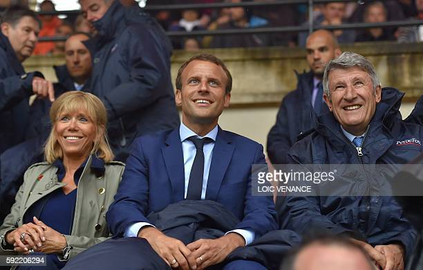 French Economy Minister Emmanuel Macron his wife Brigitte Trogneux and French 'Mouvement pour la France' president and creator of the PuyduFou theme...