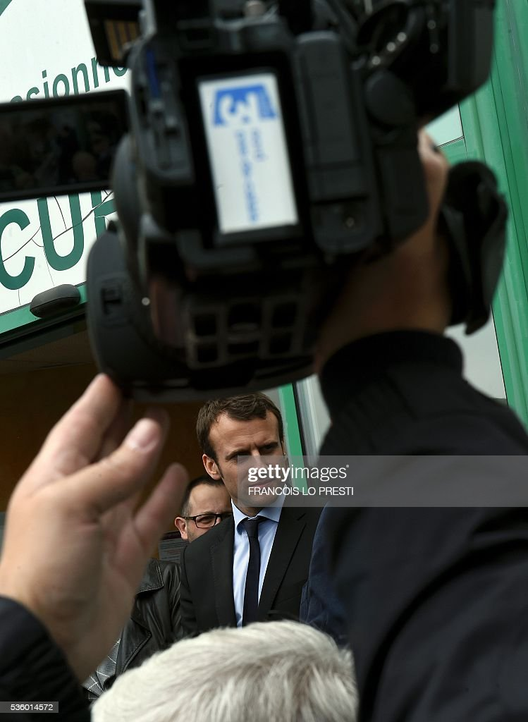 French Economy Minister Emmanuel Macron is pictured as he visits the AFPA 'La Sentinelle' training centre on May 31, 2016 in Valenciennes, after a meeting on reindustrialisation in the North of France. / AFP / FRANCOIS