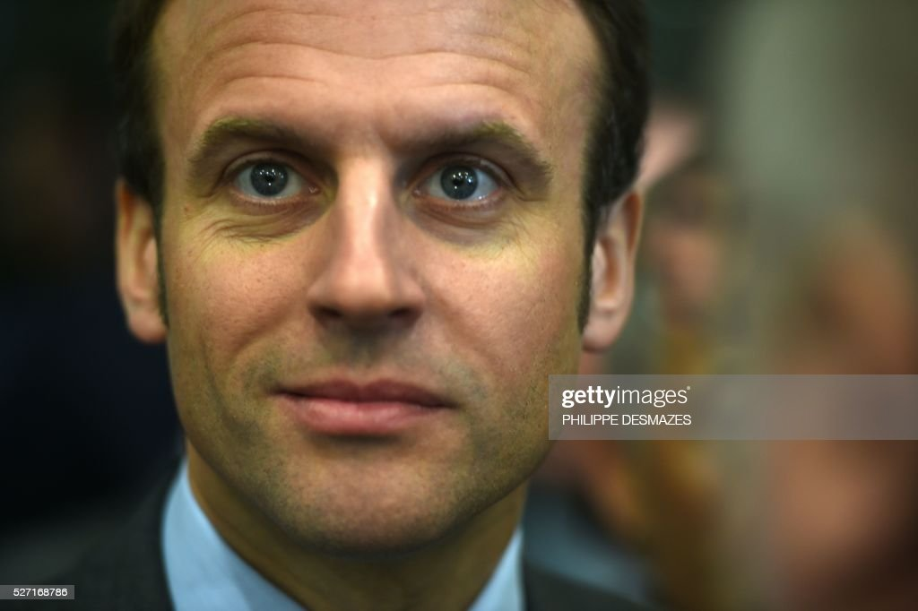 French Economy minister Emmanuel Macron is pictured during the inauguration of ID'EES group's new factory IDEM, that produces cellulose wadding from cardboard, on May 2, 2016, in Fragnes central-eastern France. ID'EES group is one of the French leaders of people's integration through the economic sector. / AFP / PHILIPPE