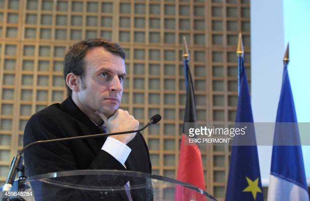 French Economy Minister Emmanuel Macron listens during a press conference with German ViceChancellor and Economy and Energy Minister Sigmar Gabriel...