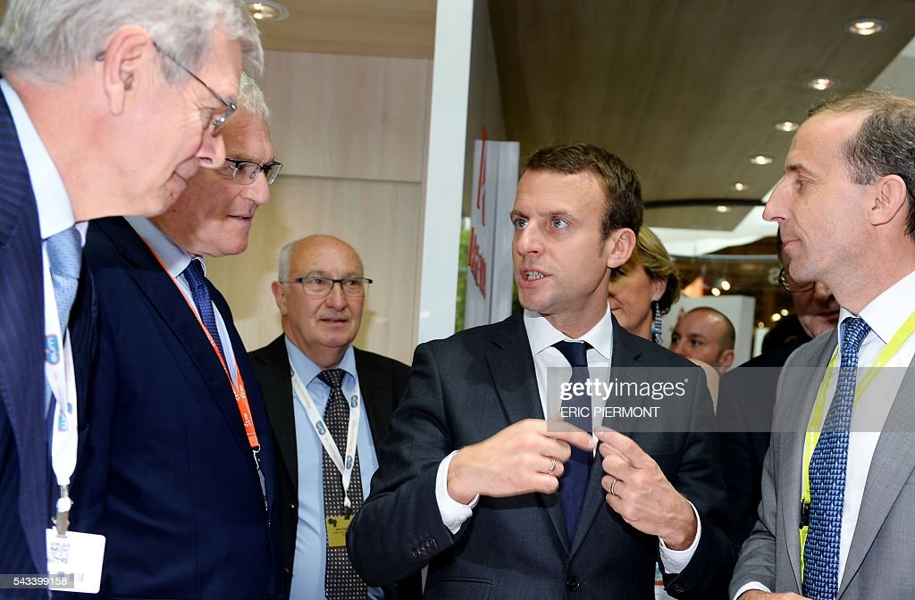French Economy Minister Emmanuel Macron (C) listens to explanations of French nuclear giant Areva's Chief Executive Officer, Philippe Knoche (R) flanked by Areva Chairman of the Board of Directors Philippe Varin (L) and France's state-run power firm EDF Chief Executive Jean-Bernard Levy (2nd L) While visiting the Areva stand at the World Nuclear Exhibition in Le Bourget, near Paris on June 28, 2016. / AFP / ERIC