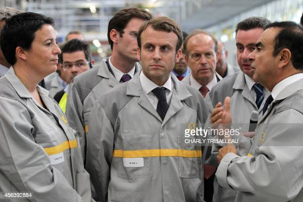 French Economy Minister Emmanuel Macron listens to French Renault car maker CEO Carlos Ghosn during the inauguration of a new production plant on...