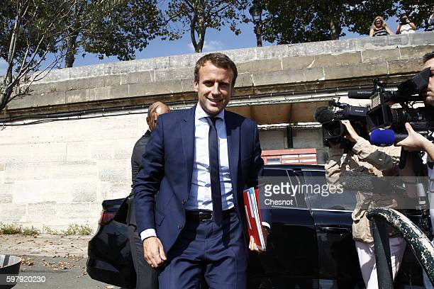 French Economy Minister Emmanuel Macron returns to the Economy Ministry after his resignation to the French President Francois Hollande at the Elysee...
