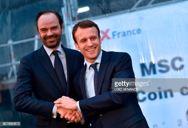 French Economy Minister Emmanuel Macron shakes hand with mayor of Le Havres Edouard Philippe during the MSC Meraviglia cruise ship coins ceremony at...