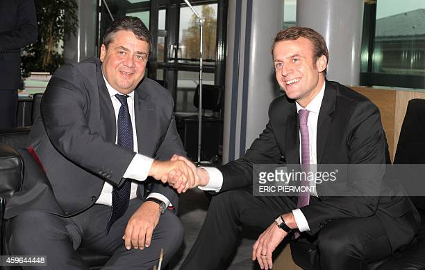 French Economy Minister Emmanuel Macron shakes hands with German ViceChancellor and Economy and Energy Minister Sigmar Gabriel during a bilateral...