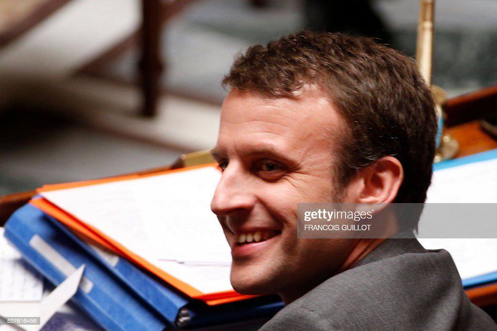 French Economy minister Emmanuel Macron smiles during a session of Questions to the government, on May 3, 2016 at the French National assembly in Paris.