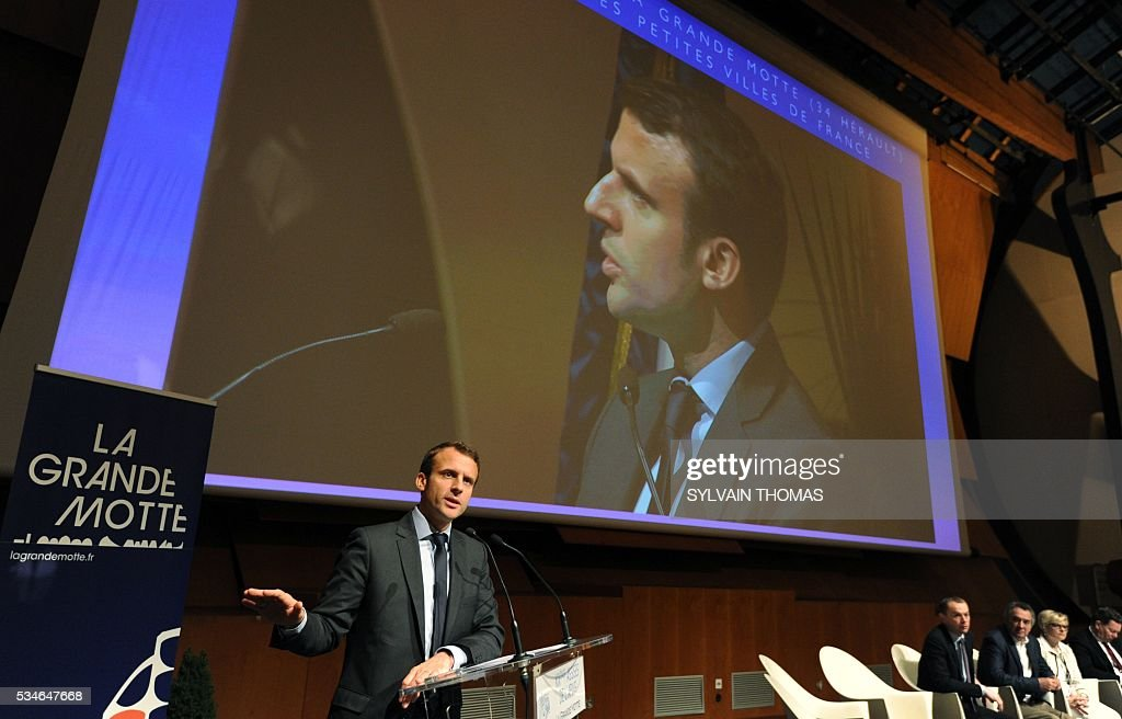 French Economy minister Emmanuel Macron speaks during a meeting of the 'Association des petites villes de France' (Association of Small Towns in France) on May 27, 2016 in la Grande-Motte, southern France. / AFP / SYLVAIN